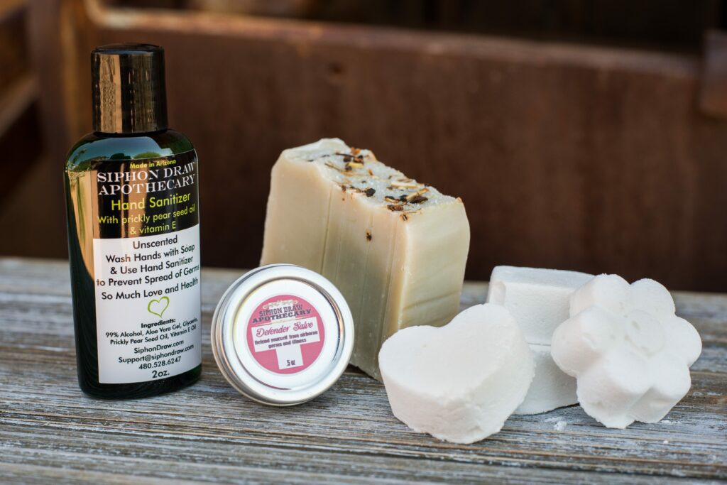 hand sanitizer, defender salve, handmade soap, and DIY bath bombs by siphon draw apothecary